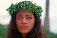 Head shot of a Hawaiian woman with a fern haku lei.