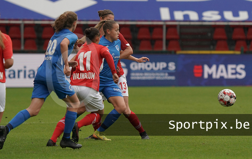 Genk's Britt Labro (17) (M), Standard's Lola Wajnblum (11) and Standard's Ellen Charlier (13) battle for the ball during a female soccer game between Standard Femina de Liege and KRC Genk Ladies  on the third matchday of the 2020 - 2021 season of Belgian Womens Super League , Saturday 3 rd of October 2020  in Liege , Belgium . PHOTO SPORTPIX.BE | SPP | SEVIL OKTEM