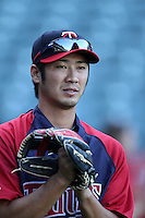 Minnesota Twins shortstop Tsuyoshi Nishioka #1 before a game against the Los Angeles Angels at Angel Stadium on September 2, 2011 in Anaheim,California. Minnesota defeated Los Angeles 13-5.(Larry Goren/Four Seam Images)