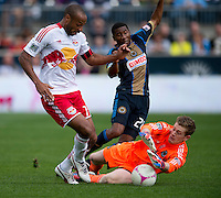 Thierry Henry (14) of the New York Red Bulls has the ball saved away from him by Zac MacMath (18) of the Philadelphia Union during the game at PPL Park in Chester, PA.  New York defeated Philadelphia, 3-0.