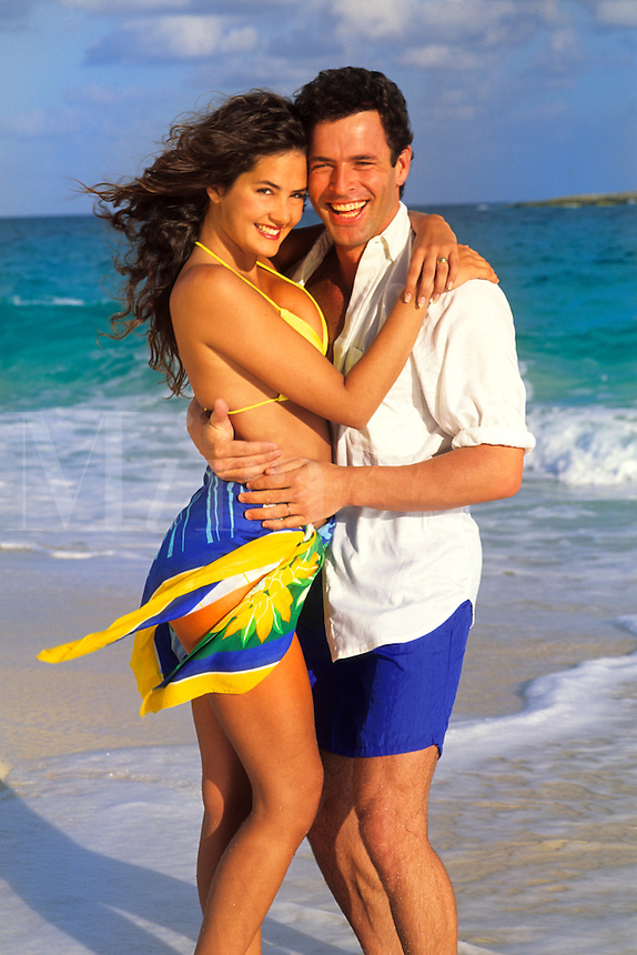 Young couple on beach.