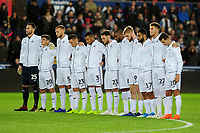 Players of Swansea City take part in a minutes silence during the Sky Bet Championship match between Swansea City and West Bromwich Albion at the Liberty Stadium in Swansea, Wales, UK. Wednesday 28 November 2018