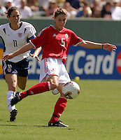 Julie Foudy, left, Andrea Neil, right, USA vs. Canada at the Third Place Match of the FIFA Women's World Cup USA 2003. USA 3, Canada, 1. (October 11, 2003). .