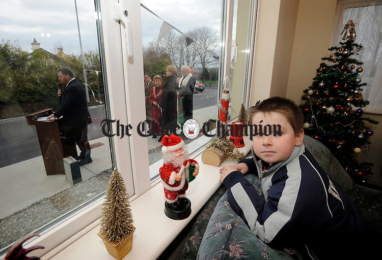 8 year old Dean Hanrahan watching proceedings from his sitting room at the official opening of Cluain Ard in Clarecastle.Pic Arthur Ellis.