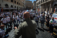 Trade Union Representative. <br /> <br /> Rome, Italy. 27th May, 2021. Today, Whirlpool workers, mainly from the South of Italy city of Naples, held a demonstration in Piazza Santi Apostoli in Rome to protest against the decision of the US multinational – manufacturer and marketer of home appliances – to close its Naples factory. Moreover, workers and their Trade Union representatives called the Italian Government, led by Prime Minister Mario Draghi, the Parliament, and all the political parties to protect jobs and workers and to make the company respecting the agreements previously made with other Italian Governments (Vertenza Whirlpool).