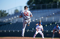 Surprise Saguaros relief pitcher Tyler Jay (52), of the Minnesota Twins organization, delivers a pitch to the plate during an Arizona Fall League game against the Scottsdale Scorpions on October 27, 2017 at Scottsdale Stadium in Scottsdale, Arizona. The Scorpions defeated the Saguaros 6-5. (Zachary Lucy/Four Seam Images)