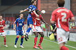 Crewe Alexandra 1 Aldershot 2, 09/09/2009. Gresty Road, League 2. Calvin Zola of Crewe Alexandra loses out to Aldershot Town's defender John Halls during the teams League 2 match at the Alexandra Stadium. The visitors won by 2 goals to 1. Photo by Colin McPherson.