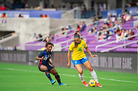 ORLANDO CITY, FL - FEBRUARY 21: Crystal Dunn #19 of the USWNT and Beatriz #16 of Brazil battle for the ball during a game between Brazil and USWNT at Exploria Stadium on February 21, 2021 in Orlando City, Florida.