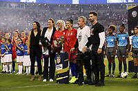 CHARLOTTE, NC - OCTOBER 3: Ali Krieger #11 of the United States poses with Kate Markgraf, Cindy Parlow Cone, and her family while being honored for playing 100 games for the national team during a game between Korea Republic and USWNT at Bank of America Stadium on October 3, 2019 in Charlotte, North Carolina.