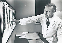 1976 FILE PHOTO - ARCHIVES -<br /> <br /> Dr. Richard Lambert examining x-rays at the Institute of Industrial Medicine. Thetford Mines, Québec<br /> <br /> The Town;  has about 4;000 mines in its surrounding asbestos fields. The region has produced about a third of the world's asbestos. Now Thetford miners are falling victim to deadly fibres.<br /> <br /> PHOTO :  John Mahler - Toronto Star Archives - AQP