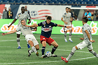 FOXBOROUGH, MA - SEPTEMBER 23: Matt Polster #8 of New England Revolution attempts to control the ball as Samuel Piette #6 of Montreal Impact defends during a game between Montreal Impact and New England Revolution at Gillette Stadium on September 23, 2020 in Foxborough, Massachusetts.