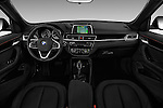 Stock photo of straight dashboard view of 2017 BMW X1 xDrive28i 5 Door SUV Dashboard