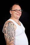 Danish man with a koifish tattoo on his upper right shoulder.<br /> From the Kolding Tattoo Convention, Denmark
