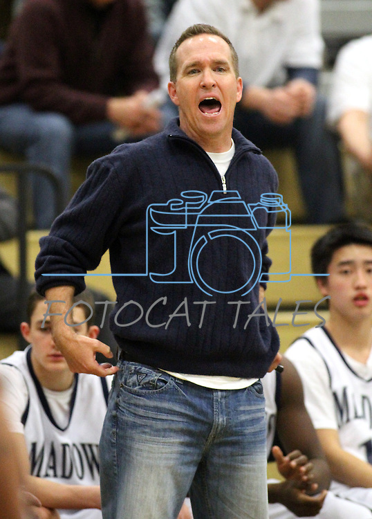 The Meadows head coach Gary Hanning watches action in a semi-final game in the NIAA 2A State Basketball Championships between The Meadows and West Wendover high schools at North Valleys High School in Reno, Nev, on Friday, Feb. 24, 2012. West Wendover won 65-62..Photo by Cathleen Allison