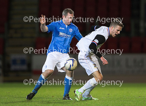 St Johnstone v Inverness Caledonian Thistle...20.12.14   SPFL<br /> Marley Watkins is fouled by Frazer Wright<br /> Picture by Graeme Hart.<br /> Copyright Perthshire Picture Agency<br /> Tel: 01738 623350  Mobile: 07990 594431