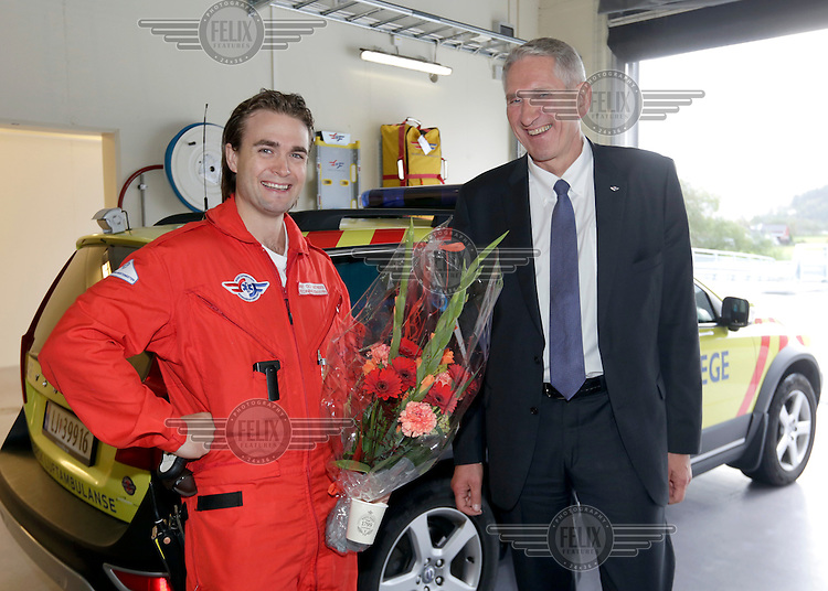 Rescue paramedic Arnt Ole Mathisen and Secretary General of Norweigan Air Ambulance Foundation , Erik Kreyberg Normann, following the opening of the new pre-hosptial base in Førde.