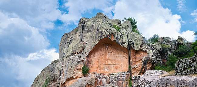 """The Unfinished rock monument of Midas, 8th - 6th century BC . Midas City, Yazilikaya, Eskisehir, Turkey.<br /> <br /> This rock facade was planned but never finished and so little is known about the unfinished Monument. It is also known locally as the Kucuk Yazilikaya ( """"little written rock""""), since it appears to have been planned as a smaller version of the Midas Monument, also called Yazilikaya. It measures 7m x 10m and faces west, unlike the other monument at Midas whose facades face east. Since it was never completed, it was gives some idea of the construction techniques : first the rock was flattened and then the facade was carved from the top down. The architectural frame and the ornament were carved at the same time. About  2m below the monument are a smaller facade, to the left and a small cut altar to the right."""