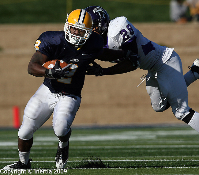SIOUX FALLS, SD - OCTOBER 31:  Joe Clark #2 of Augustana tries to shake the grasp of Brandon  White #28 of Winona State in the fourth quarter Saturday afternoon at Kirkeby-Over Stadium. (Photo by Dave Eggen/Inertia).