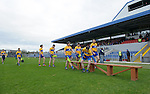 The Clare team make their way to the bench for a photo before their Division 2, Round 2 National League game against Down at Cusack Park. Photograph by John Kelly.