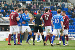 St Johnstone v Hearts....24.03.12   SPL.Ref Steven McLean separates the players as the Hearts players try and unsettle Fran Sandaza prior to his penalty.Picture by Graeme Hart..Copyright Perthshire Picture Agency.Tel: 01738 623350  Mobile: 07990 594431