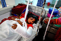 Amena Begum receives treatment at a hospital after being severaly injured during the blaze. At least 112 people died, and more than 100 were injured at a fire at the Tazreen Fashions textile factory in Dhaka. Bangladesh's garment industry has a notoriously bad fire safety record; if the right precautions had been taken, the fire could have been prevented.