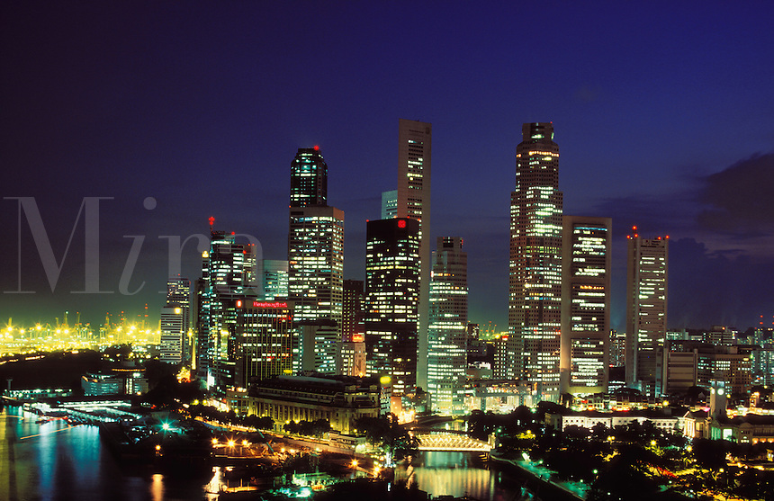 Singapore The financial district the old administrative area Boat Quay and container terminal evening