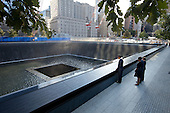 """Sept. 11, 2011.""""Chuck Kennedy captured this scene with a remote camera as the President and First Lady, along with former President George W. Bush and former First Lady Laura Bush, paused at the North Memorial Pool of the National September 11 Memorial in New York City. The North Memorial pool sits in the footprint of the north tower, formerly 1 World Trade Center."""" .Mandatory Credit: Chuck Kennedy - White House via CNP"""