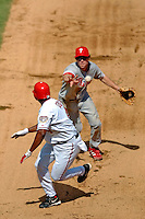 4 September 2005: Chase Utley, second baseman for the Philadelphia Phillies, gets Deivi Cruz out in a rundown at second, during a game against the Washington Nationals. The Nationals defeated the Phillies 6-1 at RFK Stadium in Washington, DC. Mandatory Photo Credit: Ed Wolfstein.