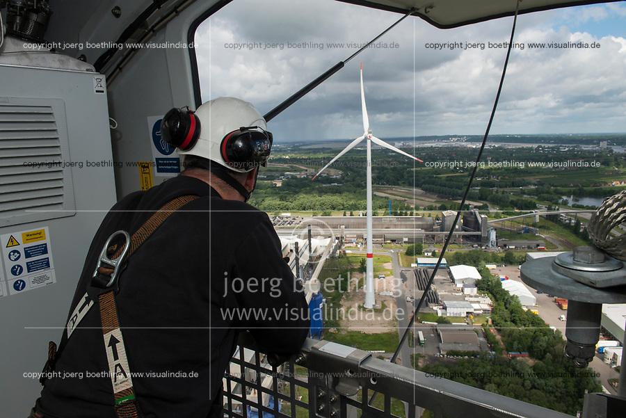 GERMANY Hamburg, wind turbine Siemens SWT-3.0-113 of Municipal energy supplier Hamburg Energie at Trimet aluminium company area / DEUTSCHLAND, Hamburg, Trimet Aluminium Werk Gelaende, Siemens Windkraftanlage SWT-3.0-113 des kommunalen Stromerzeuger Hamburg Energie, Siemens Service Techniker