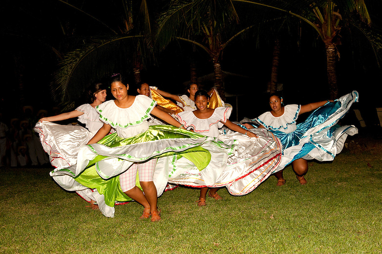 This group of local dancers is called 'Tierra Fertile' or Fertile Earth.  They are from the village of Pilas, which is located on the Nicoya Peninsula, in the north-pacific province of Guanacaste in Costa Rica.  Members of the community wanted to teach the local kids about their roots, their values and traditions.  As a result, they started this group to encourage the kids to learn more about their culture through dance. The songs, costume and dance is typical and traditional in the province of Guanacaste.  They perform at Punta Islita Hotel and Resort for select groups.