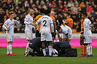 Team medical staff check on Nathan Dyer of Swansea City after he was fouled by Ruben Vinagre of Wolverhampton Wanderers during the Emirates FA Cup match between Wolverhampton Wanderers and Swansea City at The Molineux Stadium, Wolverhampton, England, UK. Saturday 06 January 2018
