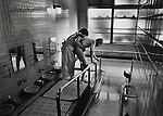"At the Hiroshima A-Bomb Survivirs Home, ""hibakusha"" (survivors), are gently bathed assembly-line style with buckets of liquid soap twice a week.  They consider it their duty to get clean from the radiation. .Pulitzer finalist entry 1989 Frederic Larson©"