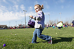 April 8, 2017- Tuscola, IL- A youngster collects plastic eggs during the annual Tuscola Kiwanis Easter Egg Hunt at Ervin Park. [Photo: Douglas Cottle]