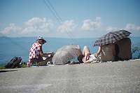 roadside fans waiting for riders to pass by and try to escape the heat on the very last climb of the 100th Tour de France<br /> <br /> Tour de France 2013<br /> stage 20: Annecy to Annecy-Semnoz<br /> 125km