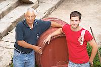 Frano and Paval Banicevic, father and son, two generations winemakers. Toreta Vinarija Winery in Smokvica village on Korcula island. Vinarija Toreta Winery, Smokvica town. Peljesac peninsula. Dalmatian Coast, Croatia, Europe.