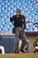 Home plate umpire Richard Genera makes a call during a game between the Fort Wayne TinCaps and Lake County Captains  on May 20, 2015 at Classic Park in Eastlake, Ohio.  Lake County defeated Fort Wayne 4-3.  (Mike Janes/Four Seam Images)