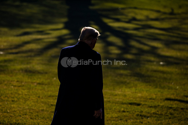 United States President Donald J. Trump departs the White House in Washington, D.C., U.S., on Tuesday, Jan. 12, 2021. The President is heading to Alamo, Texas today to visit the border wall between the United States and Mexico. This is the Presidents first appearance following the insurrection at the U.S. Capitol by his followers last week. <br /> Credit: Samuel Corum / Pool via CNP /MediaPunch