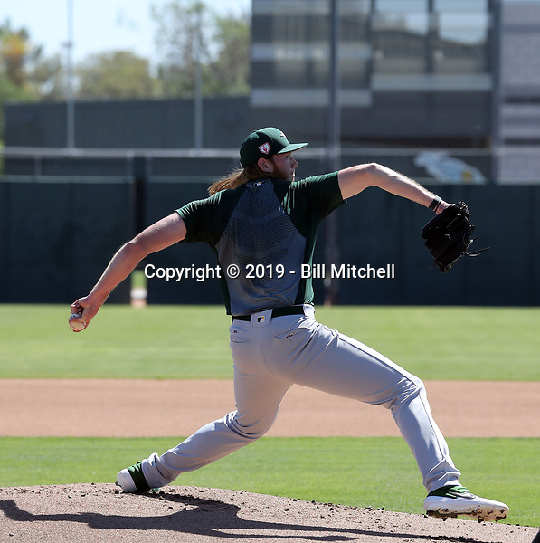 AJ Puk pitches his first live batting practice session since his 2018 ligament replacement surgery at the Oakland Athletics complex during extended spring training at Fitch Park on April 27, 2019 in Mesa, Arizona (Bill Mitchell)