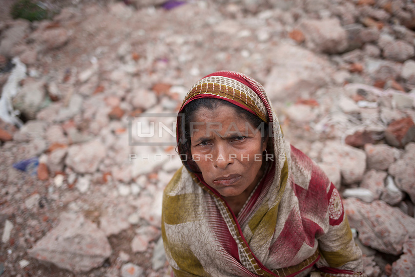 Jahanara Begum mourns at Rana Plaza site. Her daughter Shirin is still missing since the collapse happened on April 24, 2013, Savar, near Dhaka, Bnagladesh. Shirin was working in one garment factory on 4th floor of Rana Plaza.