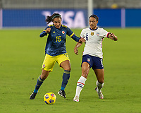 ORLANDO, FL - JANUARY 22: Lynn Williams #6 plays the ball away from Orianica Velasquez #15 during a game between Colombia and USWNT at Exploria stadium on January 22, 2021 in Orlando, Florida.