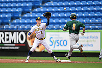 Michigan Wolverines first baseman Jacob Cronenworth (2) stretches for a throw as Dan Lowndes (8) runs through the bag during the first game of a doubleheader against the Siena Saints on February 27, 2015 at Tradition Field in St. Lucie, Florida.  Michigan defeated Siena 6-2.  (Mike Janes/Four Seam Images)