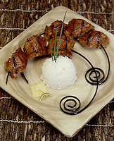 Barbeque Rattlesnake with white rice on curved skewer