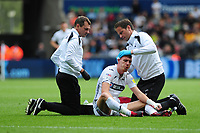 Jay Fulton of Swansea City receives treatment during the Sky Bet Championship match between Swansea City and Nottingham Forest at the Liberty Stadium, in Swansea, Wales, UK. Saturday 15 September 2018