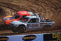 Dec. 10, 2011; Chandler, AZ, USA;  LOORRS pro 4 unlimited driver Carl Renezeder and Adrian Cenni during round 15 at Firebird International Raceway. Mandatory Credit: Mark J. Rebilas-