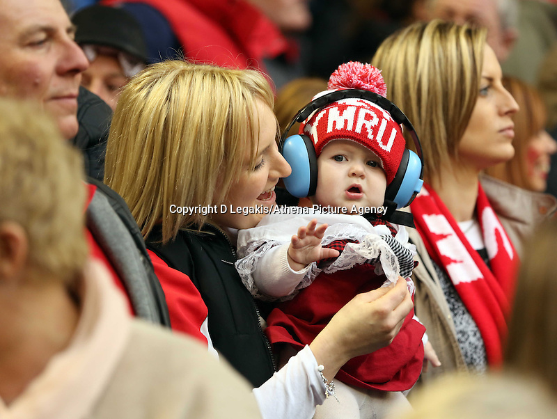 Pictured: A mother with her young child, both Wales supporters celebrate their team's win Saturday 14 March 2015<br /> Re: RBS Six Nations, Wales v Ireland at the Millennium Stadium, Cardiff, south Wales, UK.