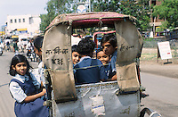 INDIA Tamil Nadu, children on the way to school with bicycle rikshaw / Indien, Kinder auf dem Weg zur Schule in einer Fahrradrikscha