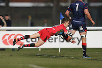 Kieran Hardy of Jersey Reds breaks free to score his first try of the game to make the score 0-15 during the Greene King IPA Championship match between London Scottish Football Club and Jersey at Richmond Athletic Ground, Richmond, United Kingdom on 18 February 2017. Photo by David Horn / PRiME Media Images.