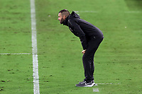 NASHVILLE, TN - SEPTEMBER 23: Head coach Ben Olsen of DC United watches from the sideline during a game between D.C. United and Nashville SC at Nissan Stadium on September 23, 2020 in Nashville, Tennessee.