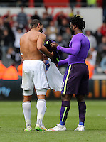 SWANSEA, WALES - MAY 17: (L-R) Ashley Williams of Swansea and Wilfried Bony of Manchester City exchange tops after the Premier League match between Swansea City and Manchester City at The Liberty Stadium on May 17, 2015 in Swansea, Wales. (photo by Athena Pictures/Getty Images)