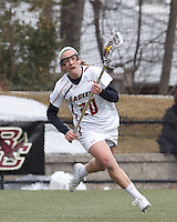 Boston College midfielder Kate McCarthy (20) brings the ball forward. .University of Maryland (black) defeated Boston College (white), 13-5, on the Newton Campus Lacrosse Field at Boston College, on March 16, 2013.